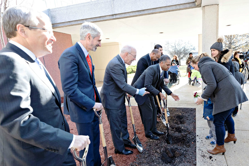 Children and families plant seeds of growth alongside community and hospital leaders at the historic Walter Reed Army Medical Campus.