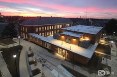 A view of the Rare Disease Institute at the Children's National Research & Innovation Campus at sunset