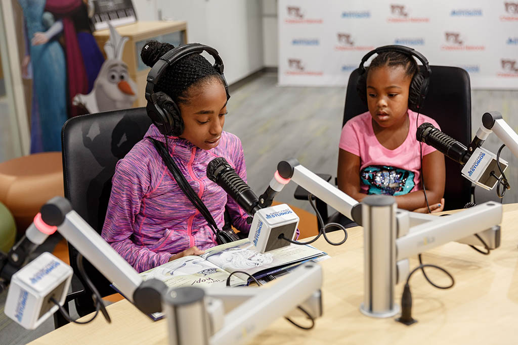 Children participate on a radio show at Seacrest Studios.