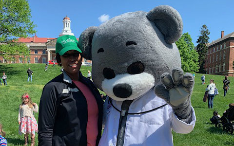 Dr Bear and Mayor Muriel Bowser pose for a photo