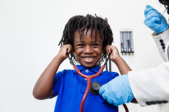 Boy listening to his heart with stethoscope