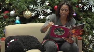 First Lady 2013 Holiday Visit opens a book