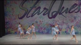 Starquest television show competitors dance on stage