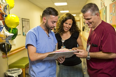 Pediatric care team members discuss a patient's chart together at Children's National.