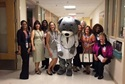 Patient and Family Advisory Council volunteers with Children's National mascot Dr. Bear.