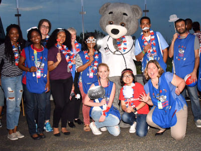 Student volunteers celebrate the 4th of July with Dr. Bear