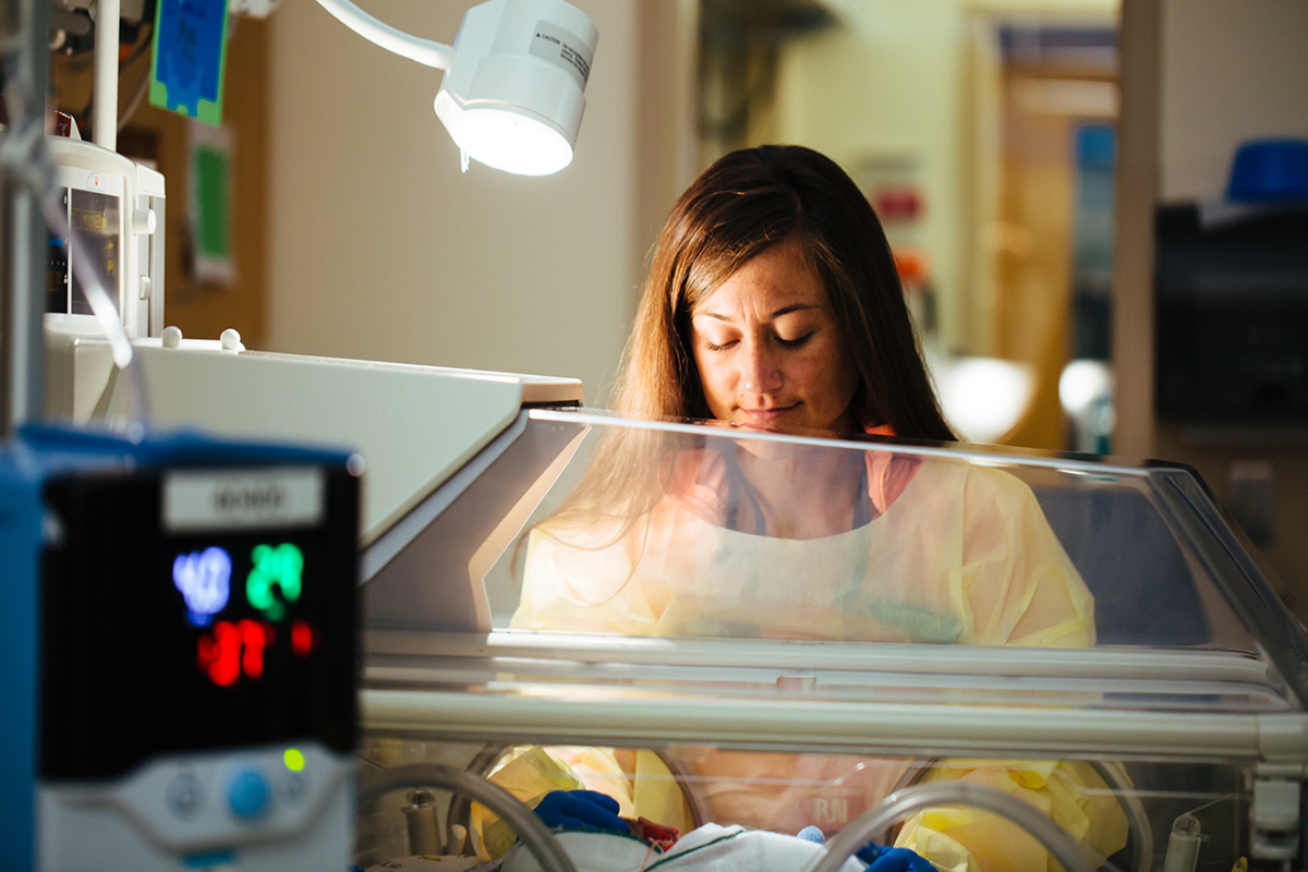 A neonatal nurse cares for a newborn in Washington DC's level 4 Neonatal Intensive Care Unit at Children's National.