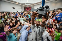 Kevin Hart taking selfie with kids