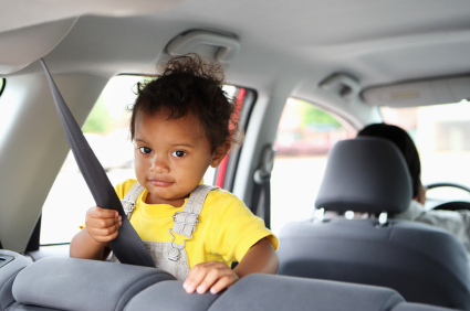 girl in car holding seatbelt
