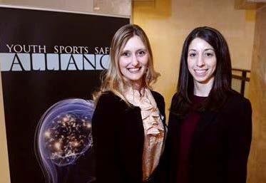 Faculty member Cat McGill with postdoc Maya Zayat (2013-2015) at the Youth Sports Safety Alliance in 2014