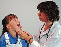 Picture of a female physician examining a young girl